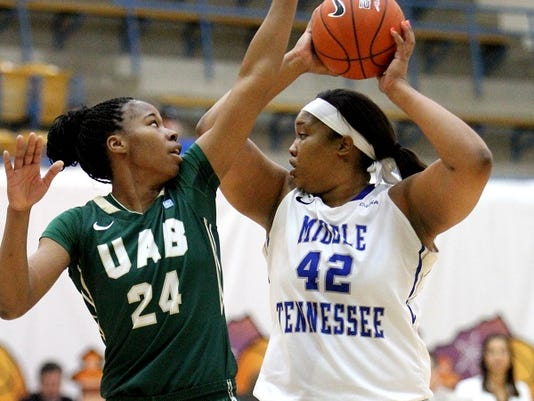 Rudy Gutierrez-El Paso Times KeKe Stewart, 42, of Middle Tennessee looks for a teammate to pass the ball too as she gets pressure from UAB's Karisma Chapman Thursday in Memorial Gym.
