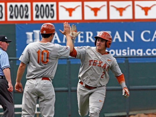 Texas's Mark Payton (2) celebrates after hitting a home run against Houston in the first inning of an NCAA college baseball tournament super regional game in  Austin, Texas, Friday, June 6, 2014.  (AP Photo/Michael Thomas)