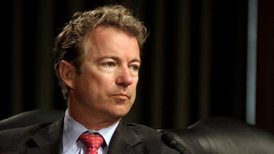 """Senate Permanent subcommittee on Investigations member Sen. Rand Paul, R-Ky. listens on Capitol Hill in Washington, Tuesday, April 1, 2014, during the subcommittee's hearing: """"Caterpillar's Offshore Tax Strategy."""