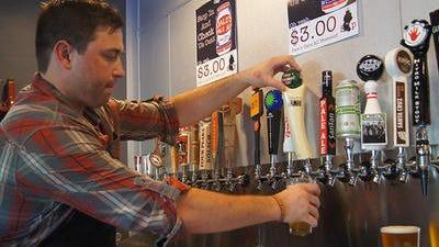 Ryan Vaughn of Sip Coffee & Beer House in Scottsdale draws one of the 22 beers on tap.