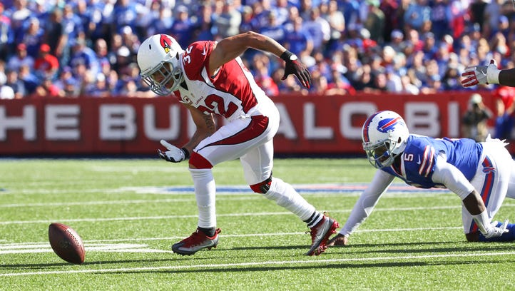 Arizona Cardinals free safety Tyrann Mathieu (32) chases a fumbled football as Buffalo Bills quarterback Tyrod Taylor (5) looks on during the second half of an NFL game on Sunday, Sept. 25, 2016, in Orchard Park, N.Y.