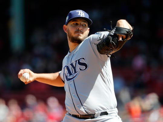 Tampa Bay Rays starting pitcher Jacob Faria delivers against the Boston Red Sox during the first inning of a baseball game at Fenway Park in Boston, Saturday, April 7, 2018. (AP Photo/Winslow Townson)