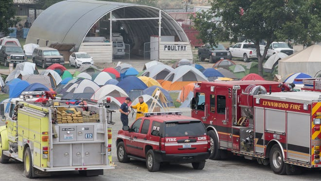 Firefighters prepare for work at a tent city in Omak, Wash., on Aug. 23, 2015.