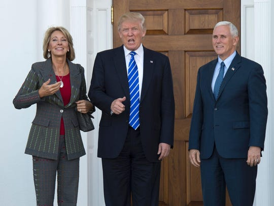 President-elect Doanld Trump and Vice President-elect Mike Pence meet with Grand Rapids area businesswoman Betsy DeVos at Trump National Golf Club on Saturday in Bedminster, New Jersey.
