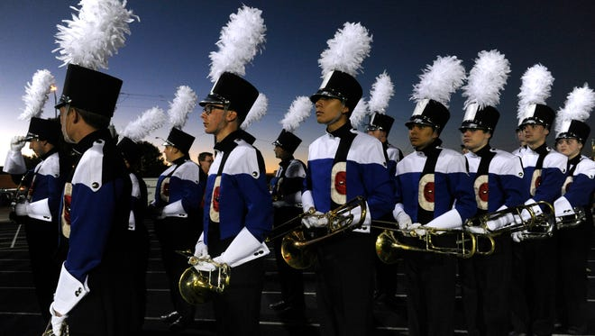 Members of the Cooper High School Awesome Cooper Band await their turn on the field during Monday's UIL Region 6 East Zone Marching Contest Oct. 23, 2017. Fifteen schools competed at Wylie High School's Bulldog Stadium.