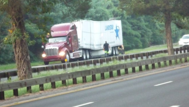 The trailer is crumpled after a tractor-trailer carrying Hallmark cards struck the King Street overpass on the northbound Hutchinson River Parkway, Sept. 2, 2015. The truck was headed from Oklahoma to Connecticut.
