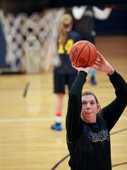 Lady Skipper's Rachel Kehoe takes a shot as she runs drills during practice December 31, 2013 at the SC4 gymnasium.