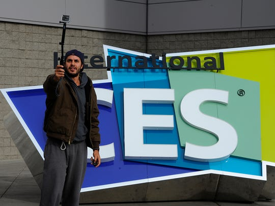 Ayoub Tamin takes a selfie in front of the CES sign. The Consumer Electronics Show runs Jan. 6-9.