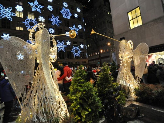 A display of angels leads the way to the Rockefeller Center Christmas tree.