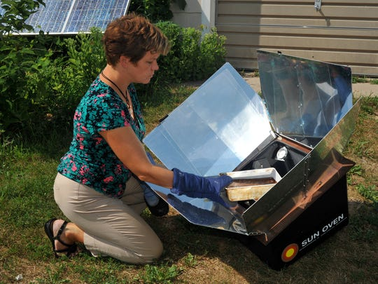 Lisa Kivirist of Inn Serendipity, Browntown, uses the power of the sun to bake with a solar oven.