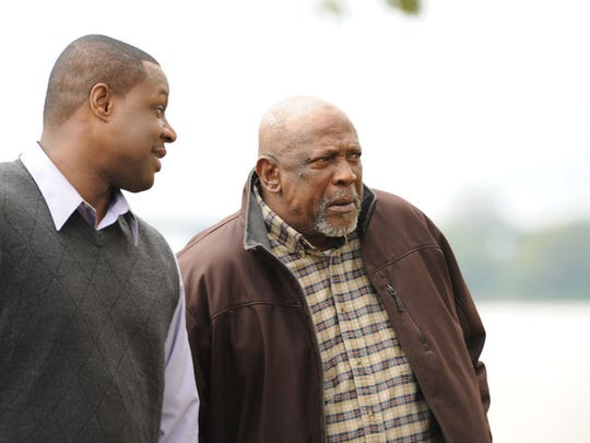 "Sam (Michael Higgenbottom) and George (Louis Gossett, Jr.) walk along the Mississippi River in a scene from the movie, ""The Grace Card."""