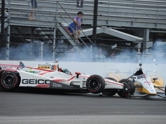 Rahal Letterman Lanigan Racing IndyCar driver Oriol Servia (16) and Dale Coyne Racing IndyCar driver James Davison (18) get involved in a crash at the Indy 500 at IMS Sunday, May 29, 2017.