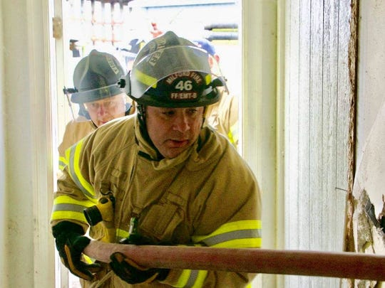Milford firefighter/EMT Joe Darkangelo leads the way with Ron Savage behind him during a training exercise for the Milford Fire Department on Feb. 25, 2017. Darkangelo says Savage collapsed and died of a heart attack about 15 minutes after this photo was taken.