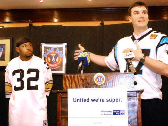 Carolina Panther quarterback Jake Delhomme of Breaux Bridge speaks to the audience gathered at the Blue Dog Cafe in Lafayette after the announcement that he and New England Patriots runningback Kevin Faulk of Carencro, left, will be spokesmen for the United Way of Acadiana this year. PHOTO SERVER/PHOTOGS/CLAUDIA BUZZ 0331 C