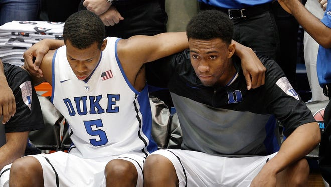 Duke Blue Devils forward Rodney Hood (5) and forward Jabari Parker (1) wait as they are introduced before their game against the Michigan Wolverines at Cameron Indoor Stadium on Dec. 3, 2013.