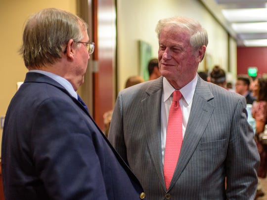President Thrasher socializes at the research showcase.