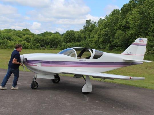 Sean O'Connor moves his plane into a good parking position