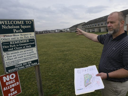 Chambersburg Recreation Department Surpervisor Guy Shaul holds the plans for a park off Bassett Drive in the  Nicholson Square development on Tuesday, March 28, 2017.