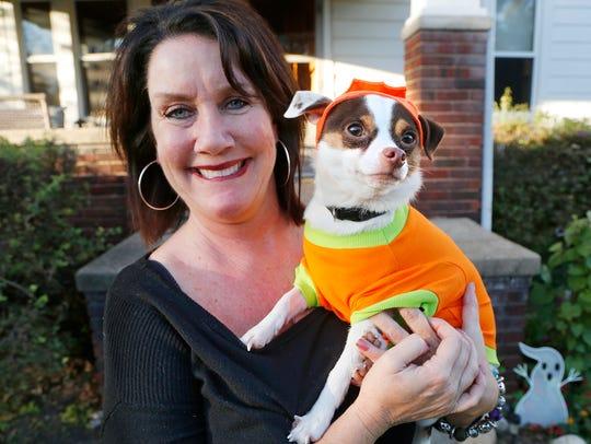 Heather Maddox and her dog Leo Wayne Maddox Wednesday,