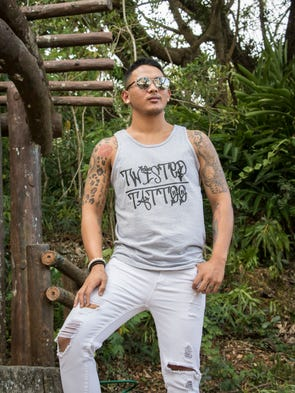 Roman Perez Jr. displays his tattoos at Latte Stone