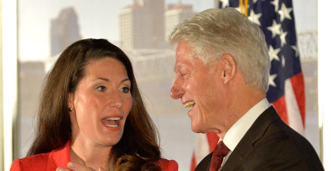 Kentucky Democratic Senate candidate Alison Lundergan Grimes speaks with former president Bill Clinton at a fundraiser in Louisville on Feb. 25.