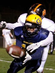 Grand Ledge's Cameron Colllins tries to pull in a pass