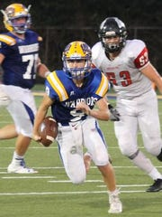 Mariemont quarterback Wally Renie finds some running