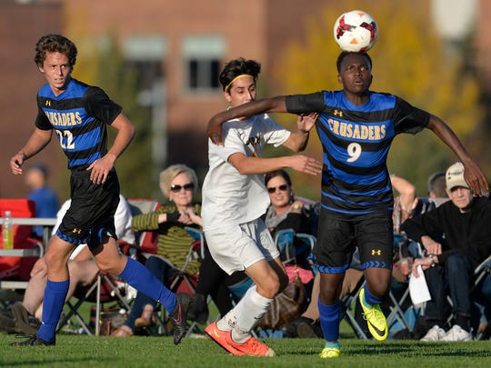 St. Cloud Cathedral's Austin Howard (9, right) heads the ball around Sauk Rapids' Ramiro Yanez-Nunez (also 9) as teammate Aidan Brew (22) looks on in the first half of their game Monday, Oct. 3, at Sauk Rapids-Rice High School.