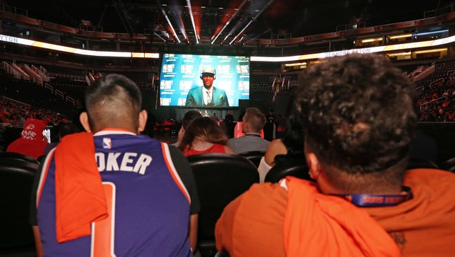 Deandre Ayton talks to the Phoenix Suns fans after being selected number one in the NBA draft on June 21, 2018, at Talking Stick Resort Arena in Phoenix, Ariz.
