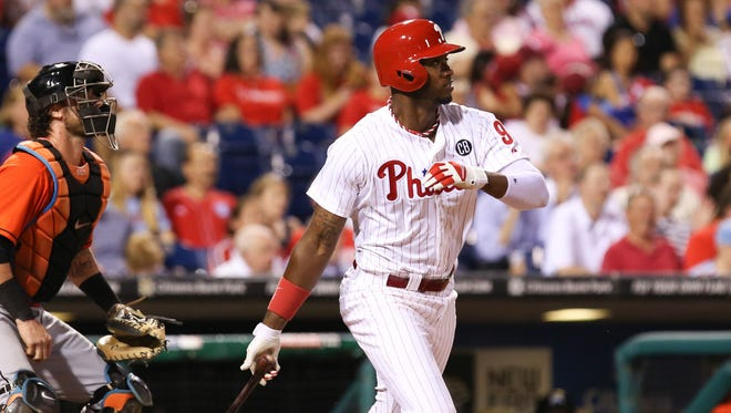 Philadelphia Phillies left fielder Domonic Brown (9) singles during the seventh inning of a game against the Miami Marlins at Citizens Bank Park. The Phillies won 5-3 in the bottom of the fourteenth inning.
