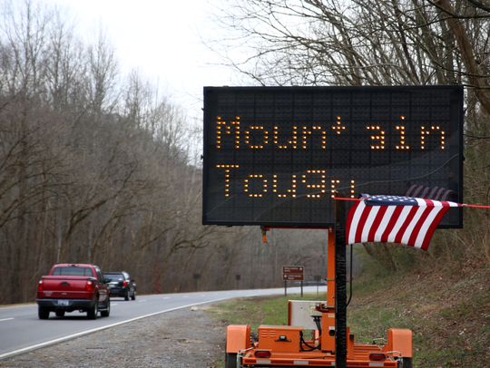 """Cars driving into  Gatlinburg are greeted with a """"Mountain"""