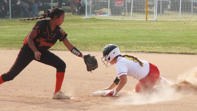 Rocky Ford High School's Baylie Krueger (9) steals second base before La Junta's Alizeh Frazier can apply the tag. The Lady Meloneers defeated the Lady Tigers 9-8 in 11 innings.