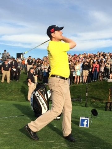 Jim Harbaugh watches the ball during the 2016 AT&T