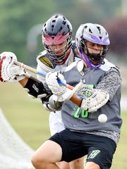 York County's Braven Morris loses the ball against a Delaware County player during pool play in the 2016 Keystone State Games boys' lacrosse tournament Saturday, July 30, 2016, in Cousler Park. The York County team consists of student-athletes from more than a dozen schools.