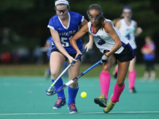Maggie Lamb (51) of Shroe Regional battles Megan MacGillis (3) of Rumson for the ball during SCT field hockey final at Monmouth University. West Long Branch,NJ. Sunday, October 30, 2016.  Noah K. Murray-Correspondent/Asbury Park Press ASB 1031 Field Hockey SCT Final