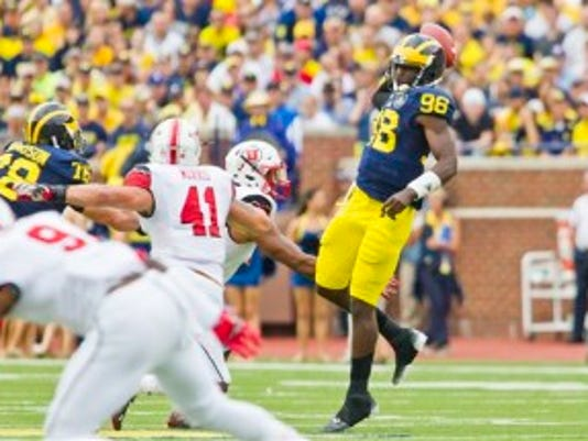 Michigan quarterback Devin Gardner (98) jumps to throw a lob pass during the first quarter of Michigan's surprising home loss to Utah two weeks ago. (AP)