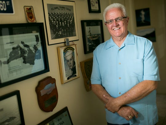 Collector Randy Debes stands next to his collection of war memorabilia on May 15, 2018, in Scottsdale.