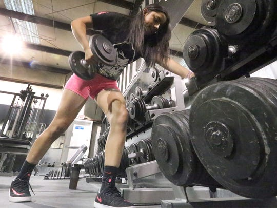 Arianna Aguilar, 13, performs an upper body workout.