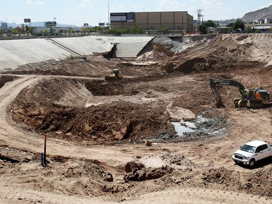Rudy GutierrezÑEl Paso Times A large stormwater pond is being carved out of the earth along Gateway West between Piedras and Copia Thursday. Another pond is being created along Gateway East across I-10. The ponds are part of the El Paso Water Untility's Central Stormwater System and has a project budget of $12,542,551 and is scheduled for completion in December, 2015.