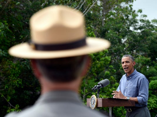 "President Barack Obama speaks about Earth Day while visiting Everglades National Park, Fla, Wednesday, April 22, 2015. Obama visited the Everglades on Earth Day to talk about how global warming threatens the U.S. economy. He says rising sea levels are putting the ""economic engine for the South Florida tourism industry"" at risk. (AP Photo/Susan Walsh)"