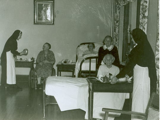 Franciscan Sisters care for the elderly at St. Otto's Home circa 1950. Before that, the building was used as an orphanage.