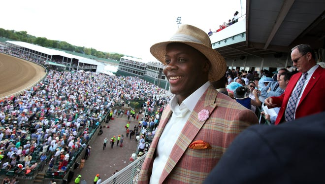 Former U of L football player and Minnesota Vikings QB Teddy Bridgewater watches races in the Skye Terrace at Churchill Downs during the Kentucky Derby.May 2, 2015