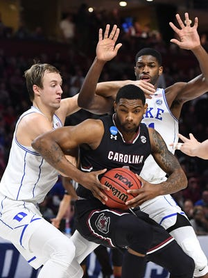 Duke guard Luke Kennard, left, and forward Amile Jefferson guard South Carolina's Sindarius Thornwell during the second round of the NCAA Tournament at Bon Secours Wellness Arena in downtown Greenville on Sunday, March 19, 2017.