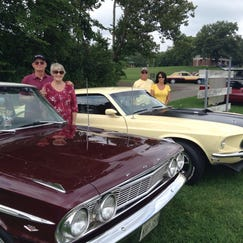 Ron and Sheila Wahl of Grosse Ile (left) and Larry and Mary Ligenza of Farmington Hills parked their cars by Nankin Mills to watch the cruise.