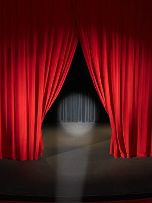 Empty stage with curtains slightly open