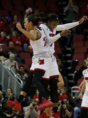 Louisville's Asia Durr, left, and Myisha Hines-Allen celebrate after Oregon calls a timeout to stop the Cards' run.