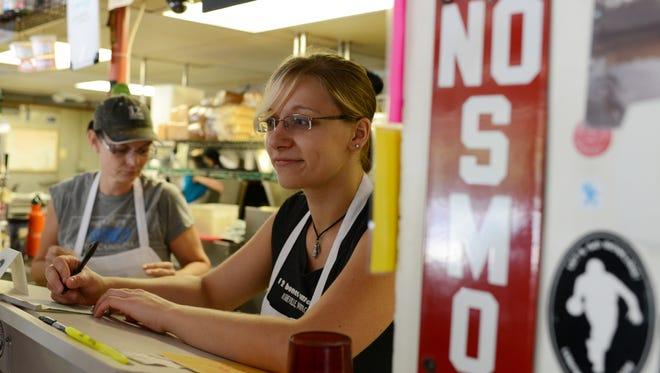 Lauren Schwab takes orders at 12 Bones last year.