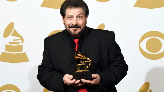 "Jo-El Sonnier poses in the press room with the award for best regional roots music album for ""The Legacy"" at the 57th annual Grammy Awards at the Staples Center on Sunday, Feb. 8, 2015, in Los Angeles. (Photo by Chris Pizzello/Invision/AP)"
