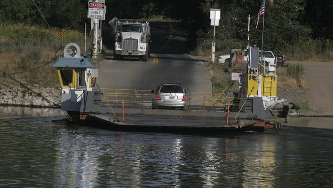 Morning commuters take the Wheatland Ferry across the Willamette River Tuesday morning July 27, 2010.