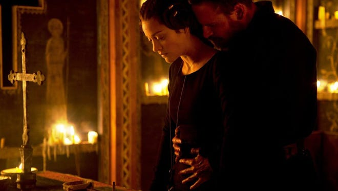 "Marion Cotillard and Michael Fassbender in ""Macbeth."""